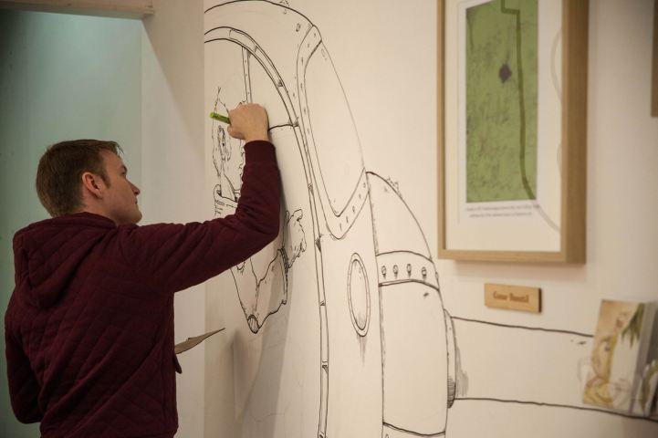 Me sketching at I am Illustrator Event
